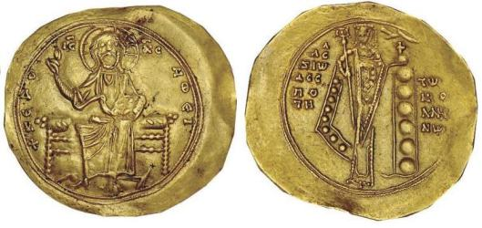 Hyperpyron trachy. Alexius I Comnenus (1081–118), minted in Constantinople. L: Christ enthroned with cross nimbus holding a gospel book and raising right hand; L: Alexius standing wearing a chlamys with jewels on hem, jewels on hem, crowned by God's hand and holding labarum and cross on globe (source: http://www.wildwinds.com/coins/byz/alexius_I/i.html)