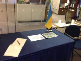 Memorial for Ukraine with a guestbook, flag, and icon; Toronto City Hall, March 7, 2014 (photo: Tay Moss)